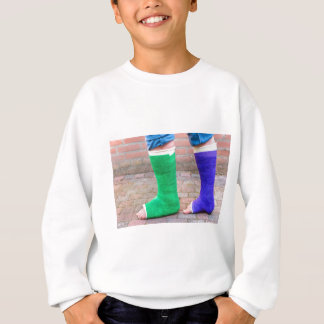 Standing child with two colorful gypsum legs sweatshirt