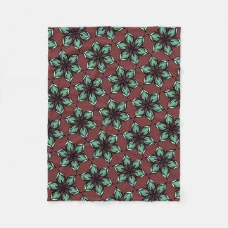 Star flower kaleidoscope on deep red brown fleece blanket