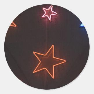 Star shaped neon lights round sticker
