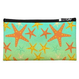 Starfish on the beach cosmetics bags