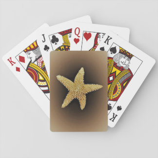 starfish playing cards brown background