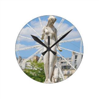 Statue depicting woman in Paris Wallclock