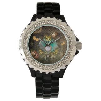 Steampunk, wonderful heart with clocks watch