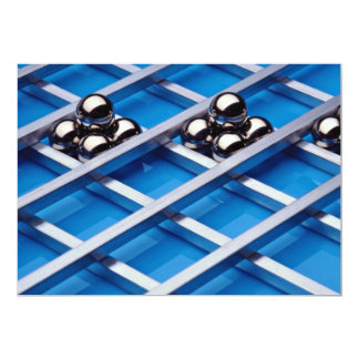 Steel balls and rods on blue acrylic invite