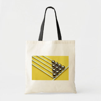 Steel balls and rods on yellow acrylic canvas bag