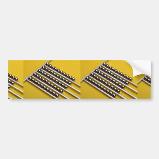 Steel balls and rods on yellow acrylic bumper stickers
