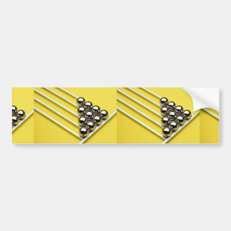Steel balls and rods on yellow acrylic bumper sticker