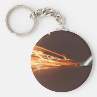 Steel tool on a grinder with sparks basic round button key ring
