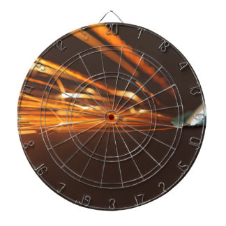 Steel tool on a grinder with sparks dartboard with darts