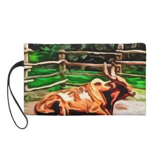 Steer bull laying down near fence painting wristlet clutch