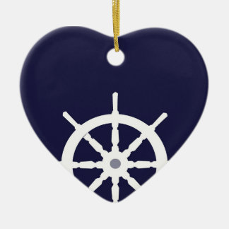 Steering wheel on navy blue background. ceramic heart decoration