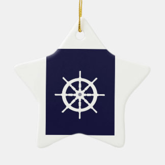 Steering wheel on navy blue background. ceramic star decoration