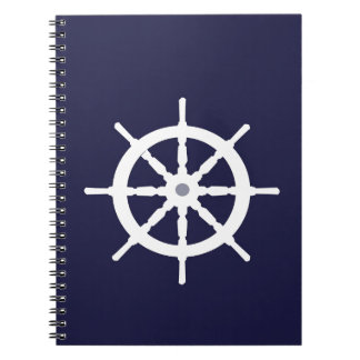 Steering wheel on navy blue background. notebooks