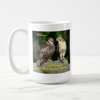 Stein or mug, with adolescent Red Tailed Hawks