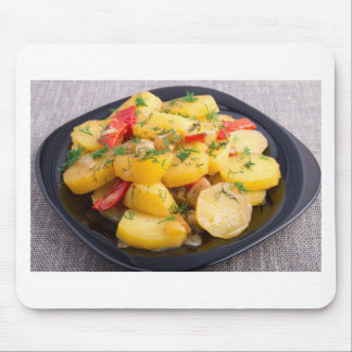 Stew of potatoes with onion, bell pepper and dill mouse pad