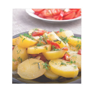 Stew of potatoes with onion, bell pepper, fennel notepad