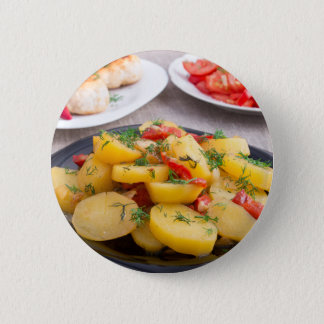 Stewed potatoes with bell pepper closeup 6 cm round badge