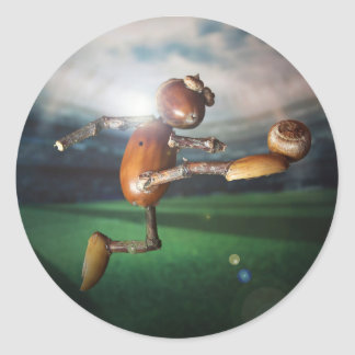 Sticker with acorn elf playing football