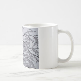 Sticky snow stuck to branches. mug