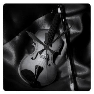 Still-life b&W image of a violin Square Wall Clock