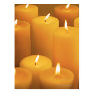 Still life of lighted candles postcard