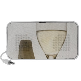 Still life of wine, cheese and fig speaker system