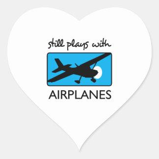 Still Plays With Plane Heart Sticker