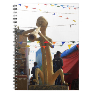 stone craft statue of street musician festivals notebooks