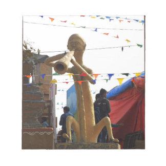 stone craft statue of street musician festivals notepad