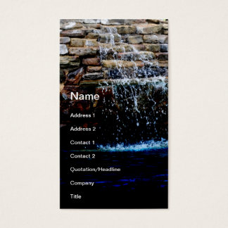 stone fountain in an in-ground swimming pool business card
