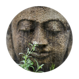 Stone garden statue with flower cutting boards
