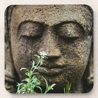 Stone garden statue with flower drink coasters