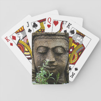 Stone garden statue with flower poker deck