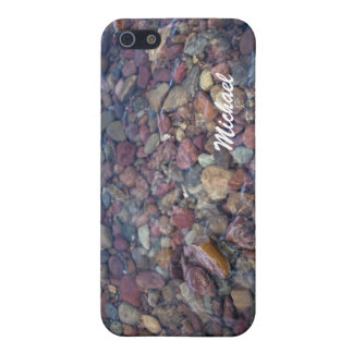 Stones in the lake at Glacier National Park iPhone 5 Covers