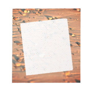 Stones one the beach in beige colors notepad
