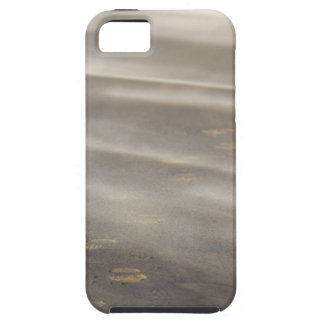 storm blowing shifting sand over boot prints 2 iPhone 5 covers