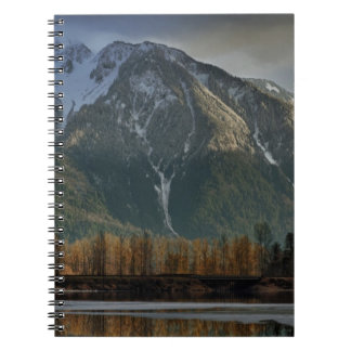 Storm clearing over mountains at sunset 2 notebooks