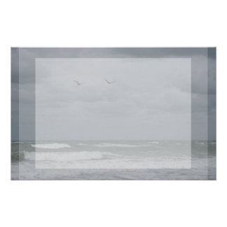 Stormy ocean with birds flying stationery