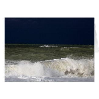 Stormy sea with waves und a dark blue sky. card