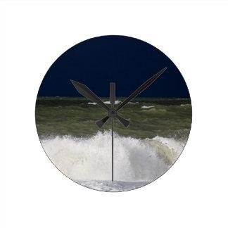 Stormy sea with waves und a dark blue sky. clock