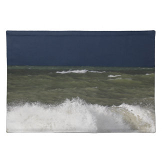 Stormy sea with waves und a dark blue sky. placemats
