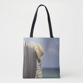 Straw Hat Hanging On Fence At Beach Tote Bag