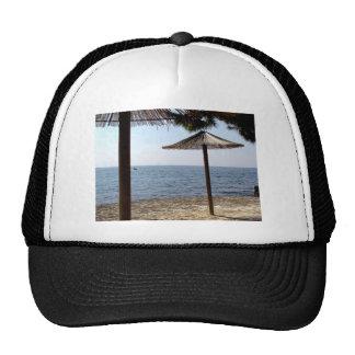 Straw Umbrellas on the Beach Cap