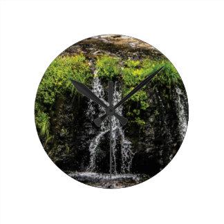 stream trickle falls round clock
