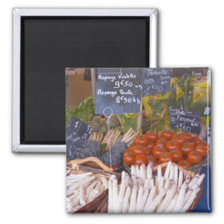 Street market merchant's stall with white refrigerator magnets