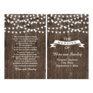 String lights on old wood folded wedding program flyer