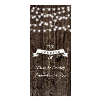 String of lights  on old wood wedding program rack card