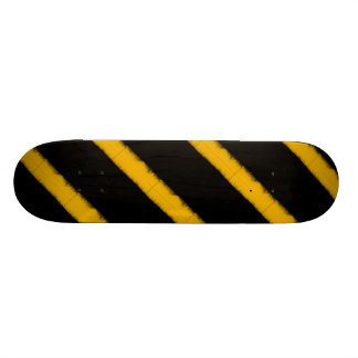 Striped yellow and black skate board deck