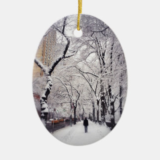 Strolling A Snowy City Sidewalk Ceramic Oval Decoration