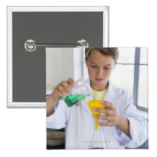 Student doing science experiment 5 buttons